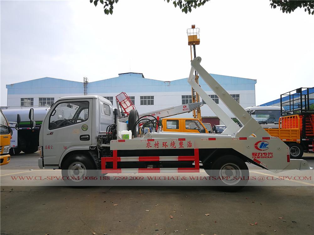 camion à ordures DCAF bras Swing