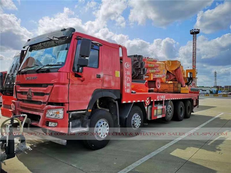 مسطحة HOWO شاحنة مع 100 طن أضعاف ذراع رافعة لأفريقيا