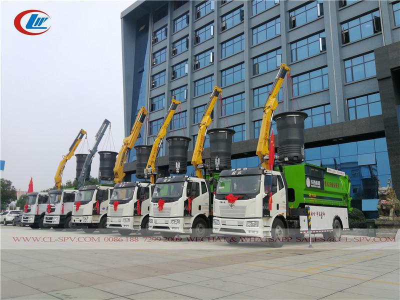 lixeira urbana enterrada e caminhão de transporte com guindaste